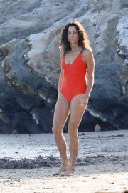 Minnie Driver in Orange Swimsuit on the beach in Malibu
