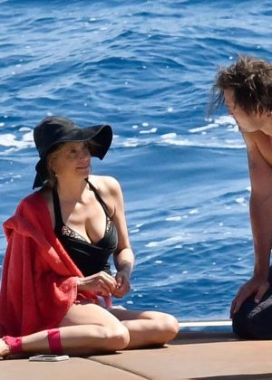 Mira Sorvino in Swimsuit on vacation in Capri