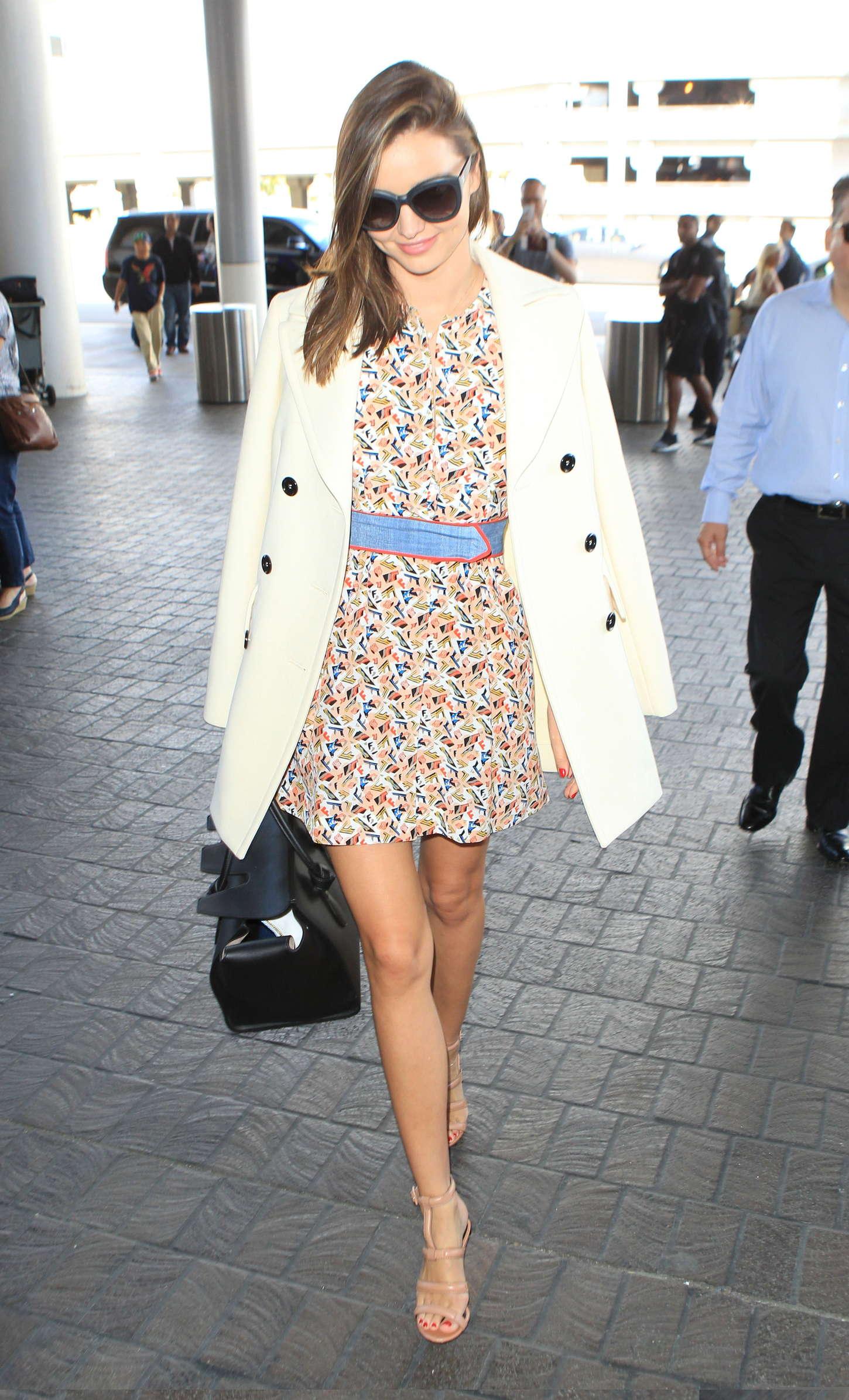 Miranda Kerr in Mini Dress at LAX Airport in LA