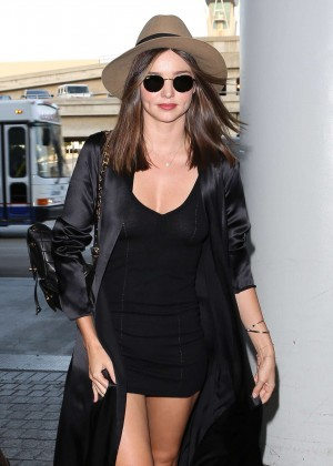 Miranda Kerr in Black Mini Dress at LAX Airport in LA
