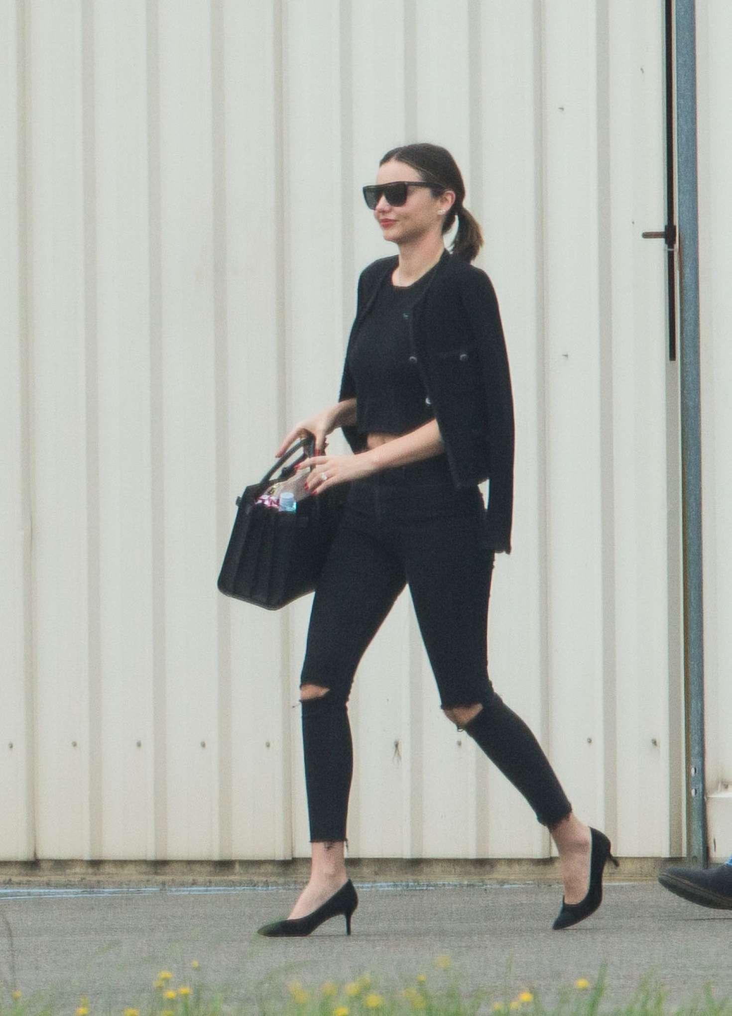 Miranda Kerr in Ripped Jeans Arrive in Sydney