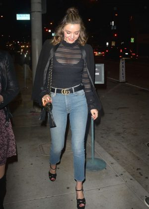 Miranda Kerr in sheer black top at Catch LA in West Hollywood