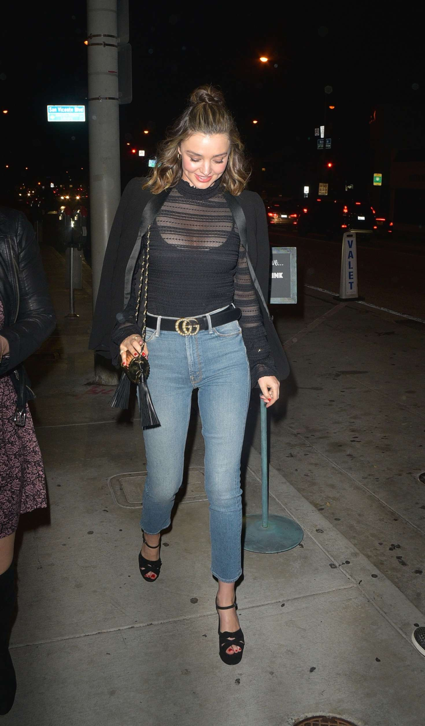Miranda Kerr in sheer black top at Catch LA in West Hollywood