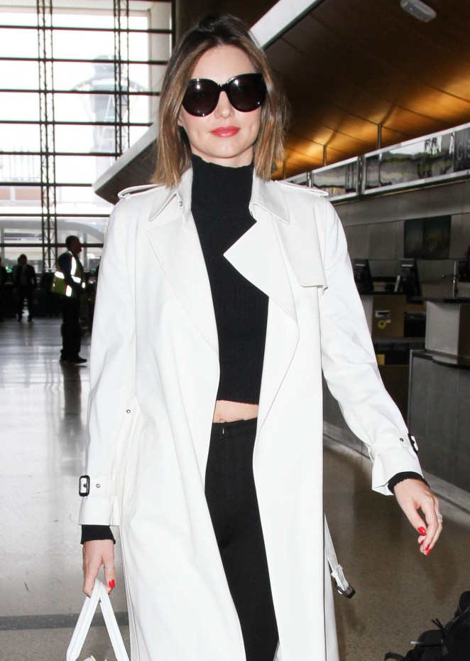 Miranda Kerr in white Coat at LAX Airport in Los Angeles