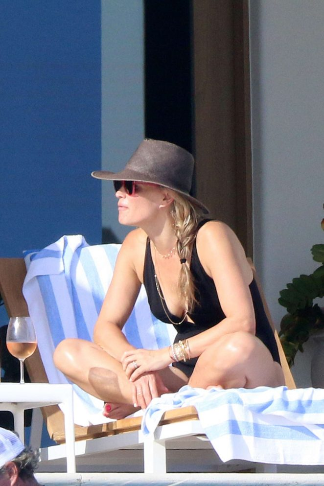 Molly Sims in Black Swimsuit on the pool in Cabo San Lucas