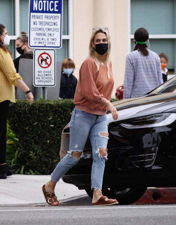 Molly Sims - In ripped jeans out in Santa Monica