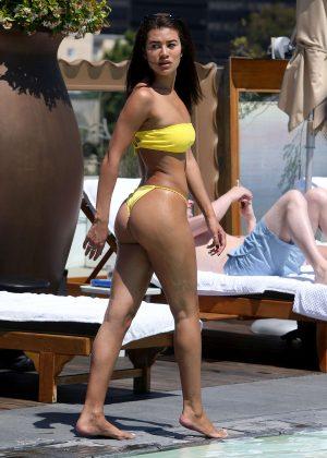 Montana Brown - Looking Hot in Yellow Bikini on the pool in Los Angeles