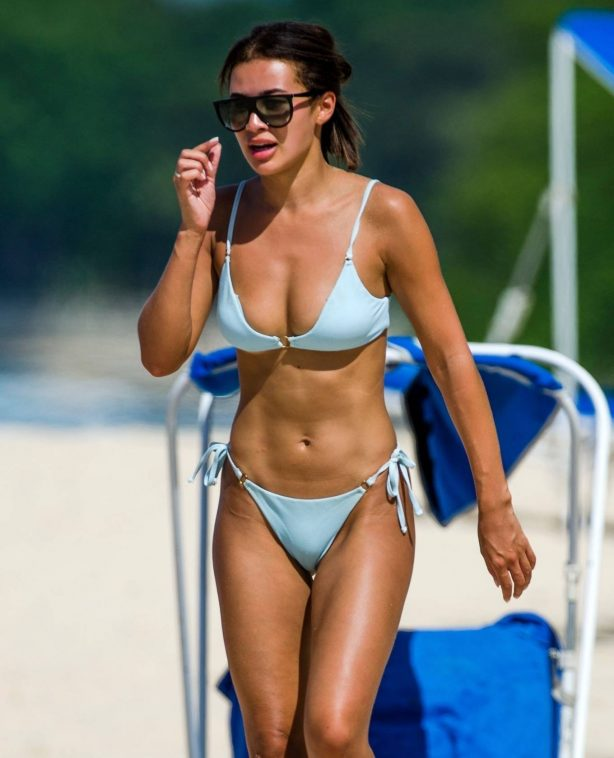 Montana Brown - Pictured in blue bikini at beach in Barbados