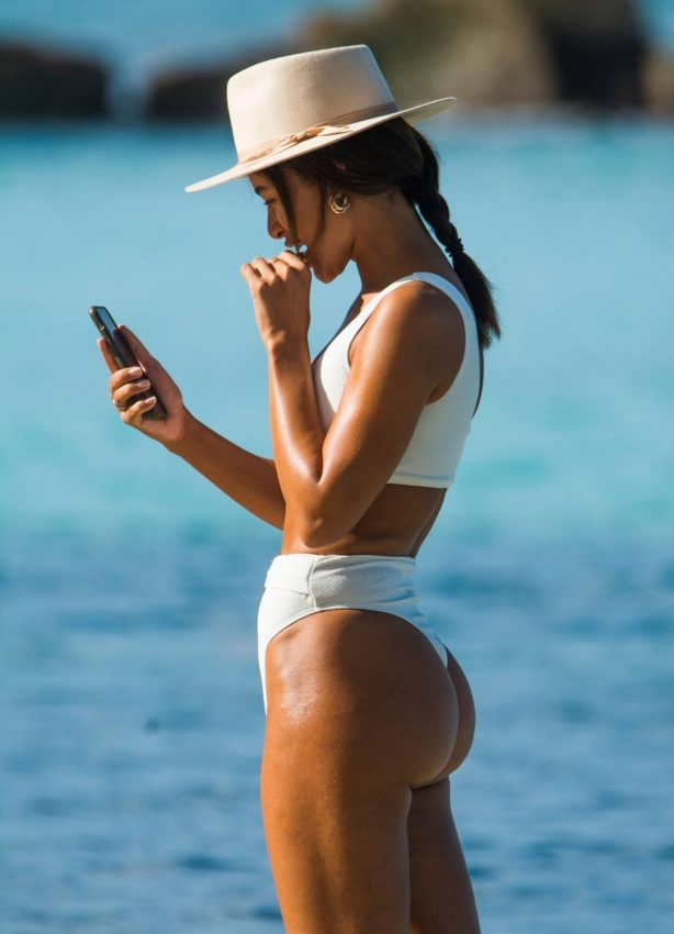 Montana Brown - Shows her beach body in a white swimsuit out in Barbados