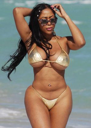 Moriah Mills in Gold Bikini at the beach in Miami