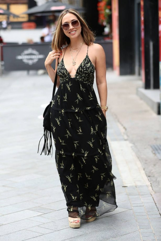 Myleene Klass at Global radio in plunging maxi dress in London
