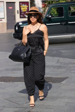 Myleene Klass - In a black  silk top and fedora at Smooth radio in London