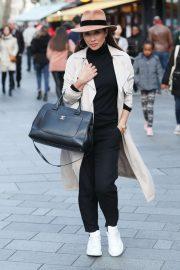 Myleene Klass in a fedora and trench coat in London