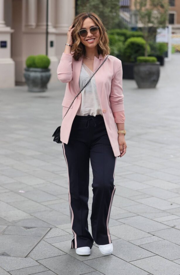 Myleene Klass - In a pink blazer and striped trousers at Smooth radio London