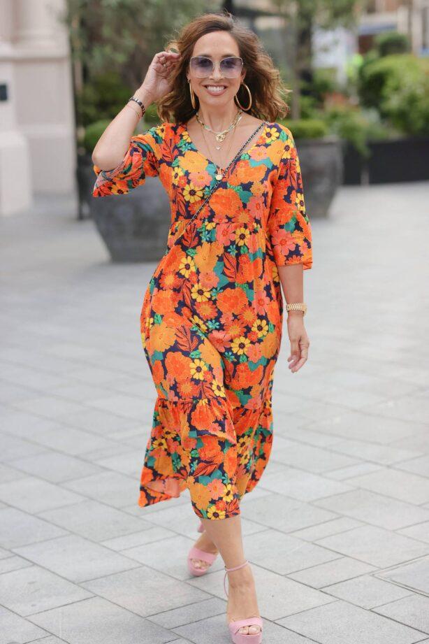 Myleene Klass - In a summer floral orange dress in London
