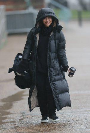 Myleene Klass - In black braves the rain gears in London