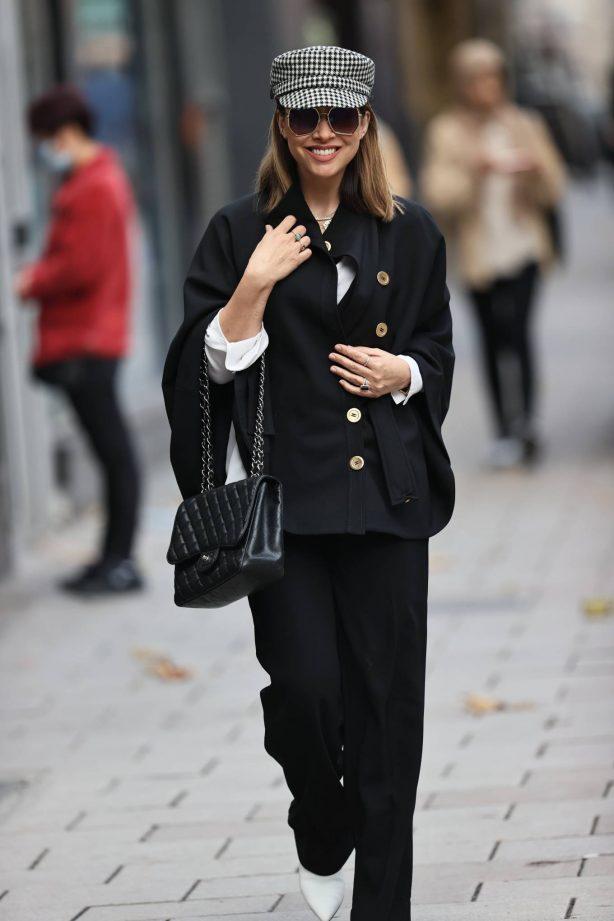 Myleene Klass - In black outfit and baker boy hat in London