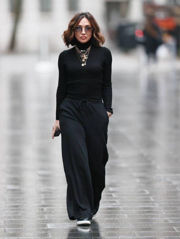 Myleene Klass - In black ribbed jumper and trousers in London