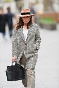 Myleene Klass in fedora hat and tweed coat upon her exit at Smooth Radio show in London