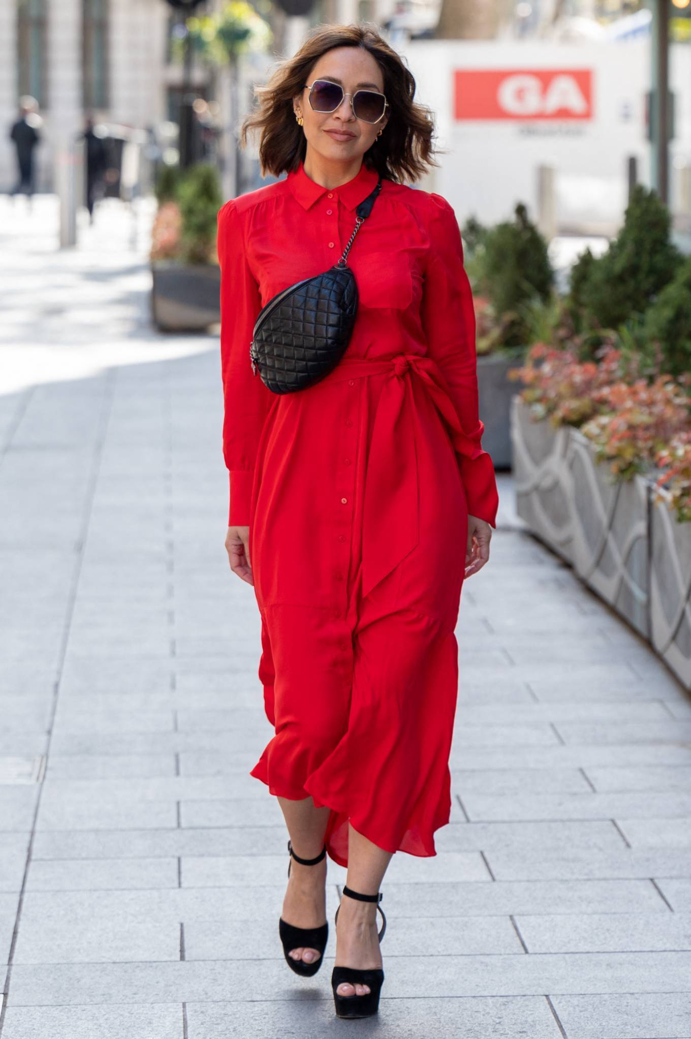 Myleene Klass - In maxi red dress arriving at Global Studios in London