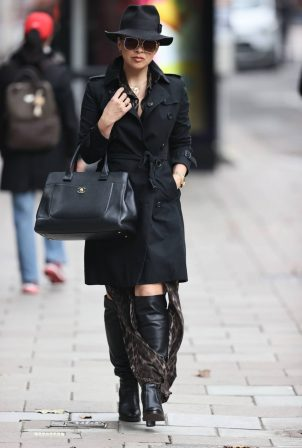 Myleene Klass - In trench coat and hat and print trousers in London