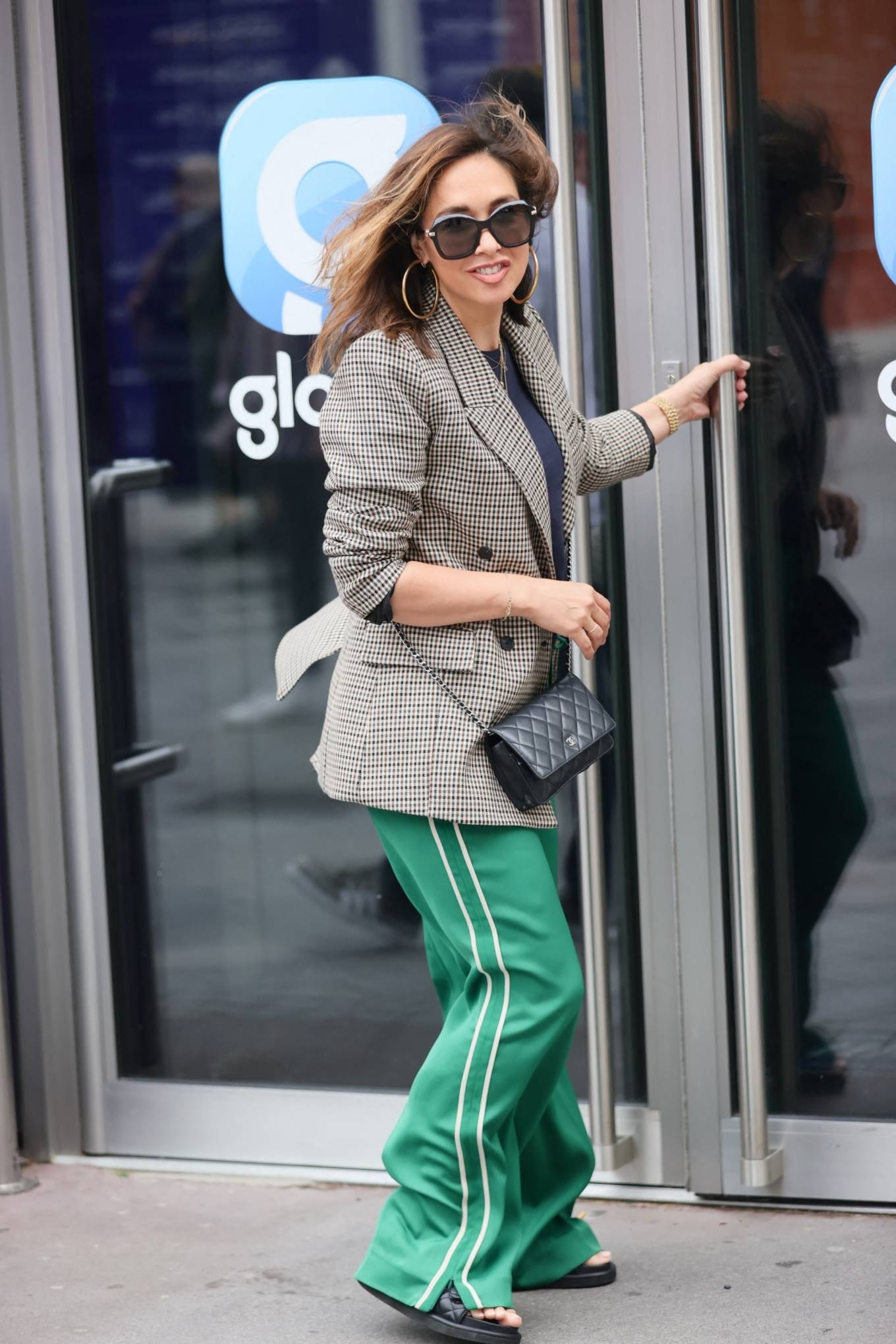 Myleene Klass - In tweed jacket and striped trousers in London