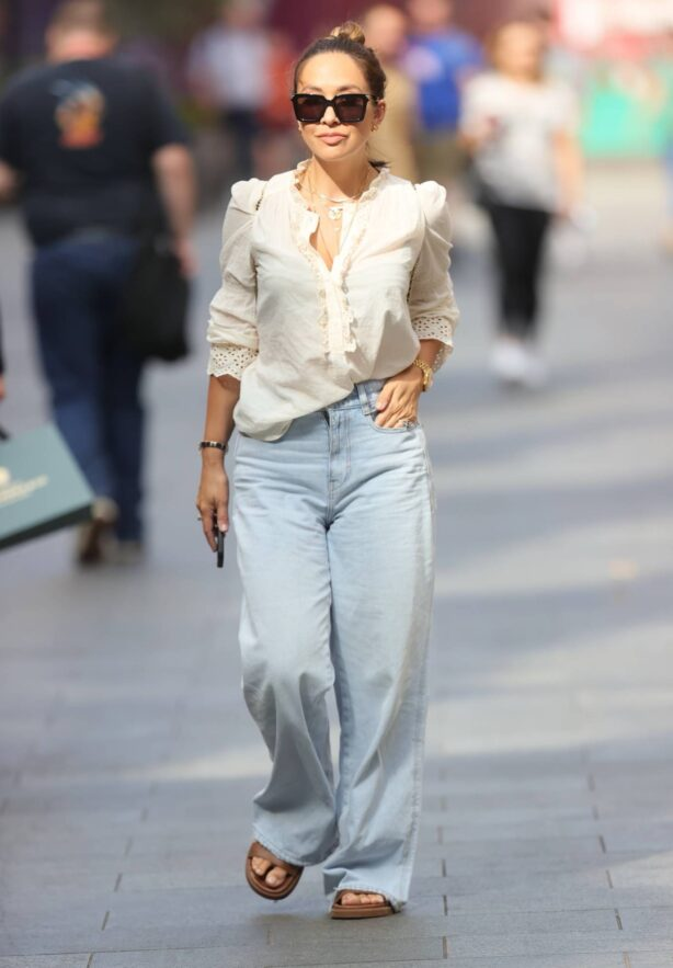 Myleene Klass - in white blouse and flared denim at Smooth radio in London