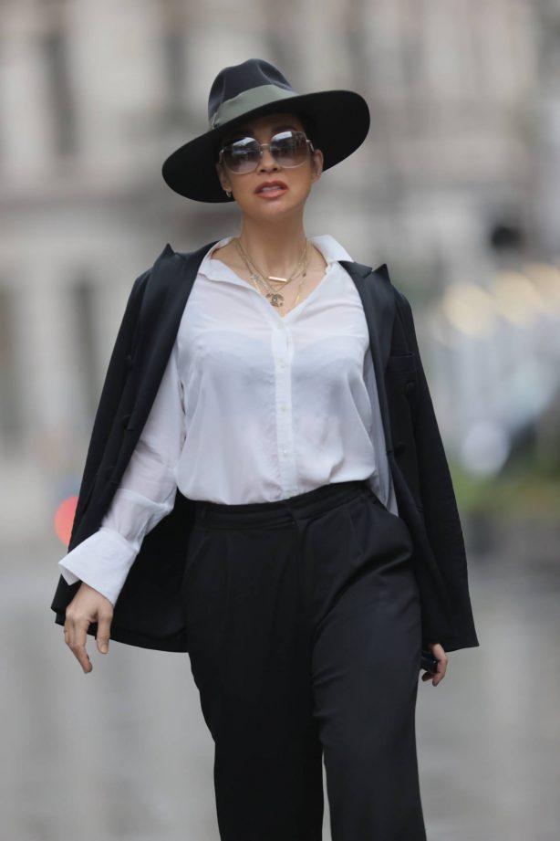 Myleene Klass - Wearing a top hat and monochrome trouser suit in London