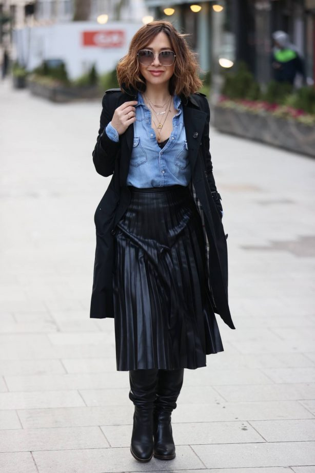 Myleene Klass - Wears a black dress and trench coat at Smooth Radio Studios in London