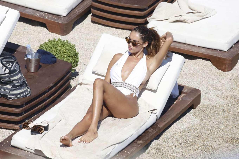 Nabilla Benattia in White Swimsuit on the beach in Mykonos