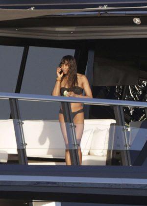 Naomi Campbell in Black Bikini on a yacht in Ibiza