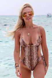 Naomi Isted in Swimsuit on the beach in the Caribbean
