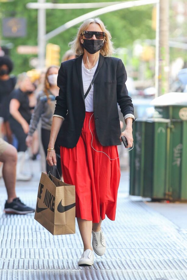 Naomi Watts - in a red skirt aseen after a stroll with a friend in New York