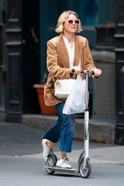 Naomi Watts - Out doing errands on a scooter in New York City