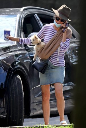 Naomi Watts - Seen with her puppy in The Hamptons