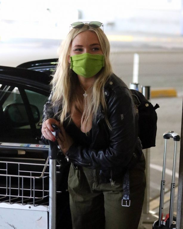 Natalie Alyn Lind - Wearing mask while arriving in Vancouver