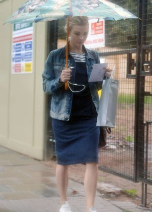 Natalie Dormer with umbrella out in London