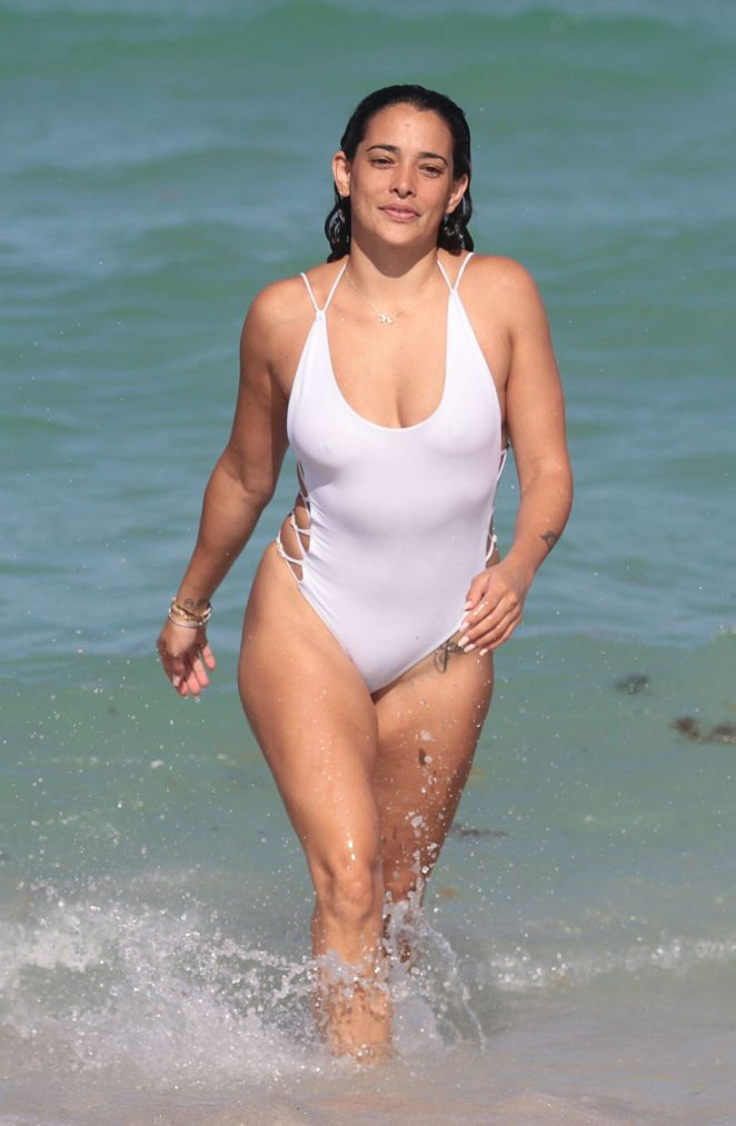 Natalie Martinez in White Swimsuit on the beach in Miami