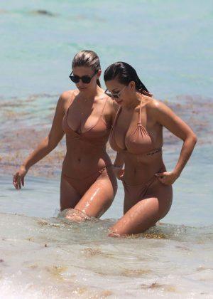 Natasha Oakley and Devin Brugman in nude colored bikinis in Miami