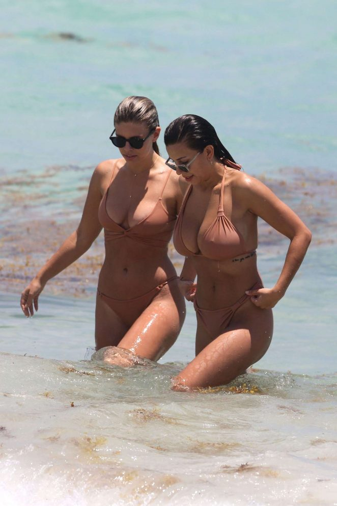 Natasha Oakley and Devin Brugman in nude colored bikinis in Miami