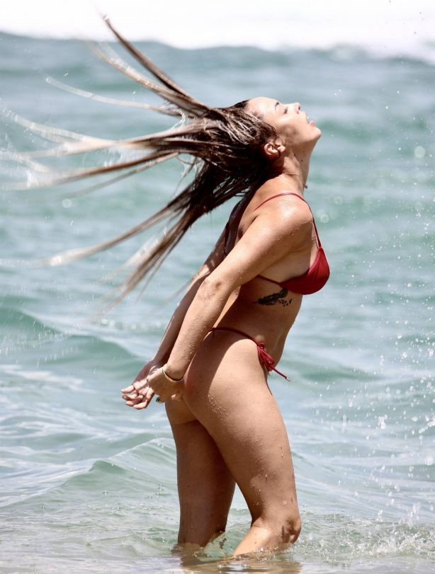 Natasha Spencer - In a red bikini at a beach on the Gold Coast