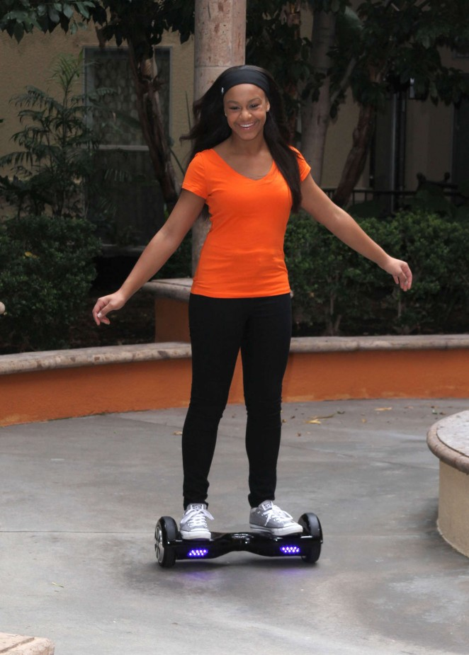 Nia Frazier - Riding a self balancing board in Los Angeles
