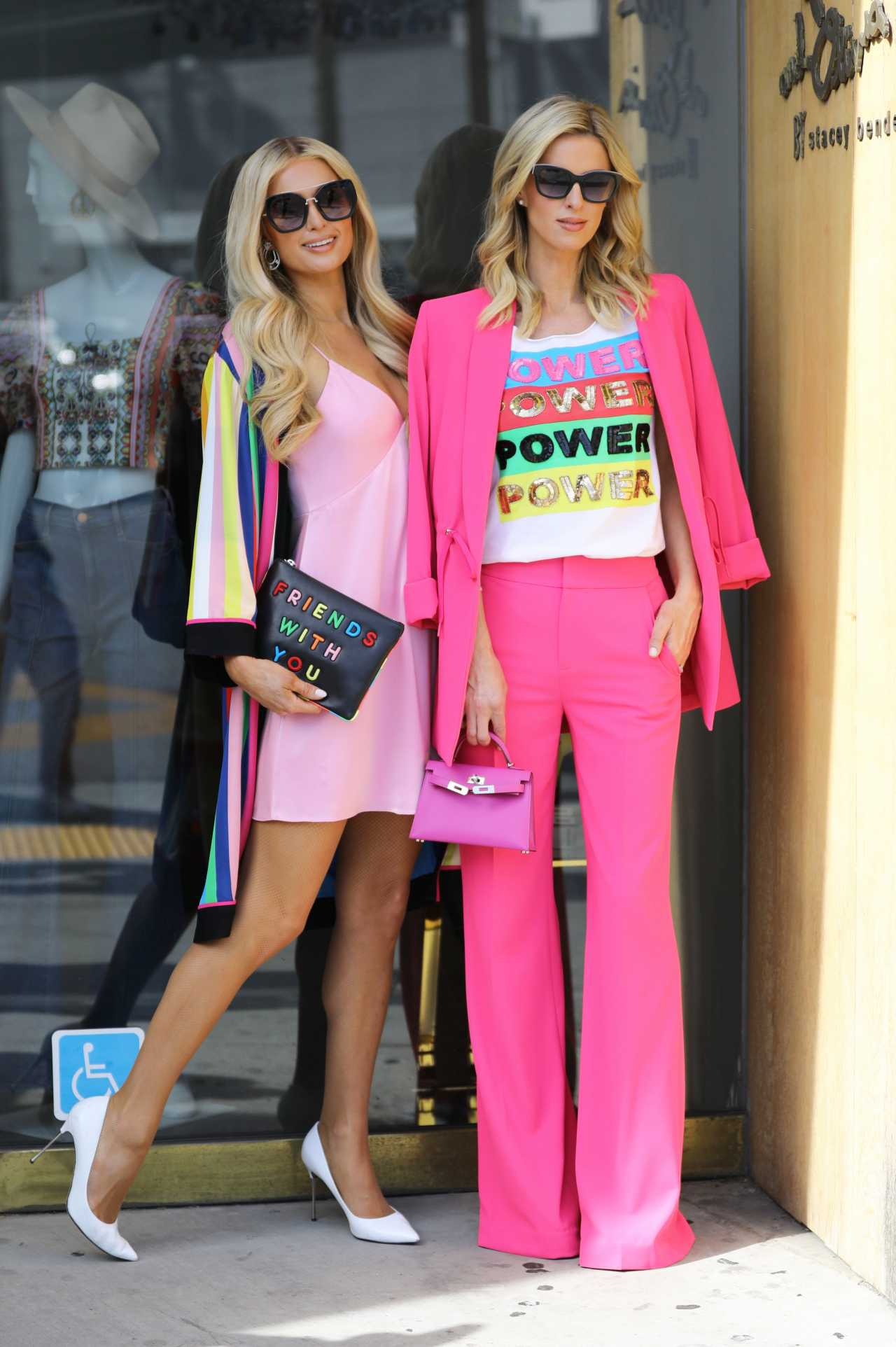 Nicky Hilton and Paris Hilton - Posing in Beverly Hills