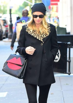 Nicky Hilton in a black coat with a leopard print collar out in New York City