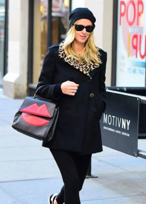 e3ab49b9 Nicky Hilton in a black coat with a leopard print collar out in New ...