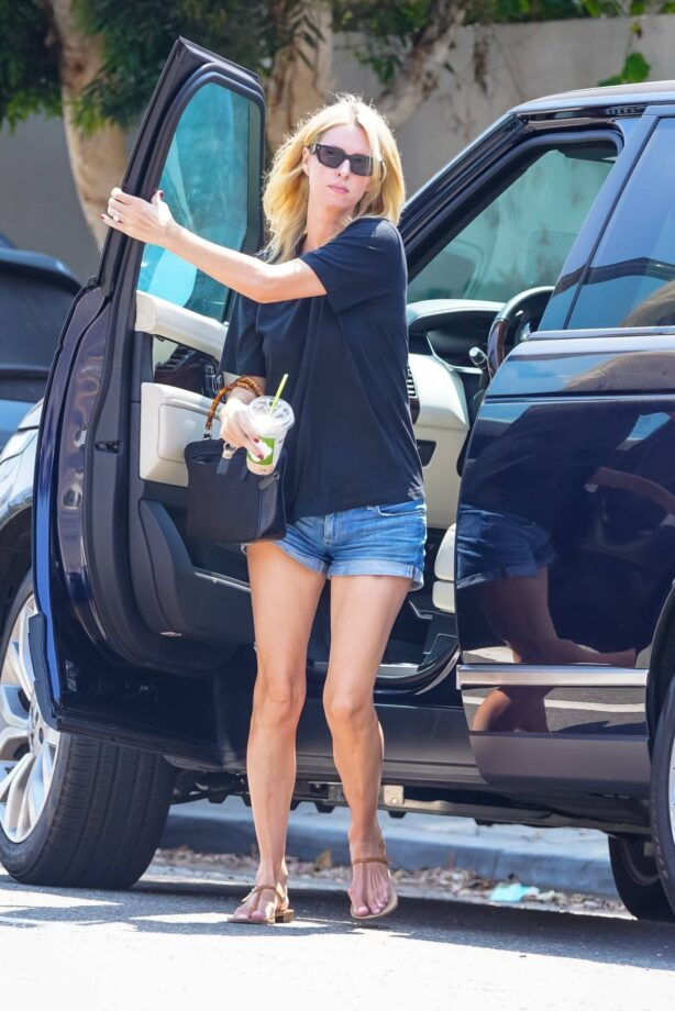 Nicky Hilton - In denim shorts and a black tee while out in Malibu