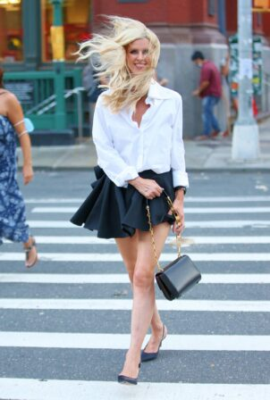 Nicky Hilton Rothschild - In a mini pleated skirt in Soho in New York