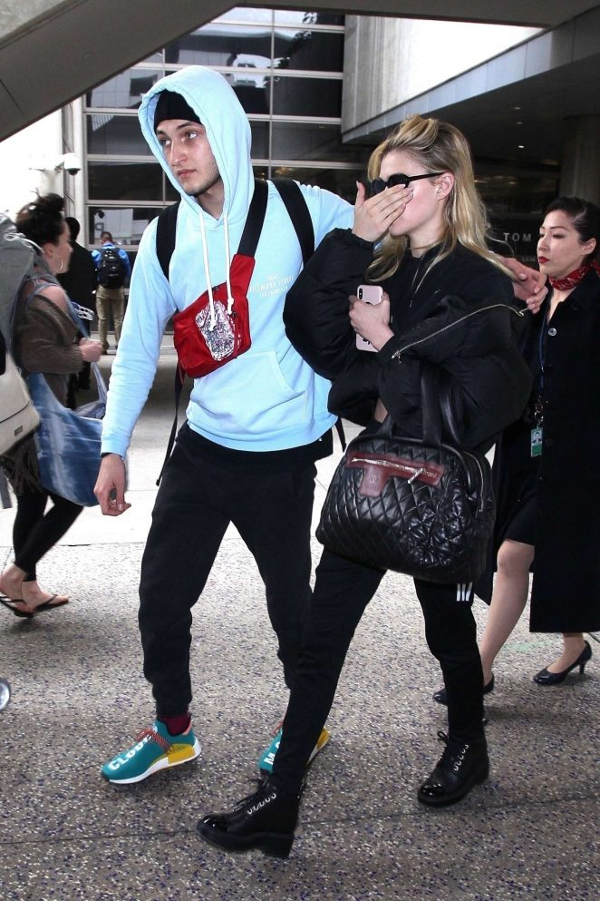 Nicola Peltz and Anwar Hadid at LAX Airport in Los Angeles