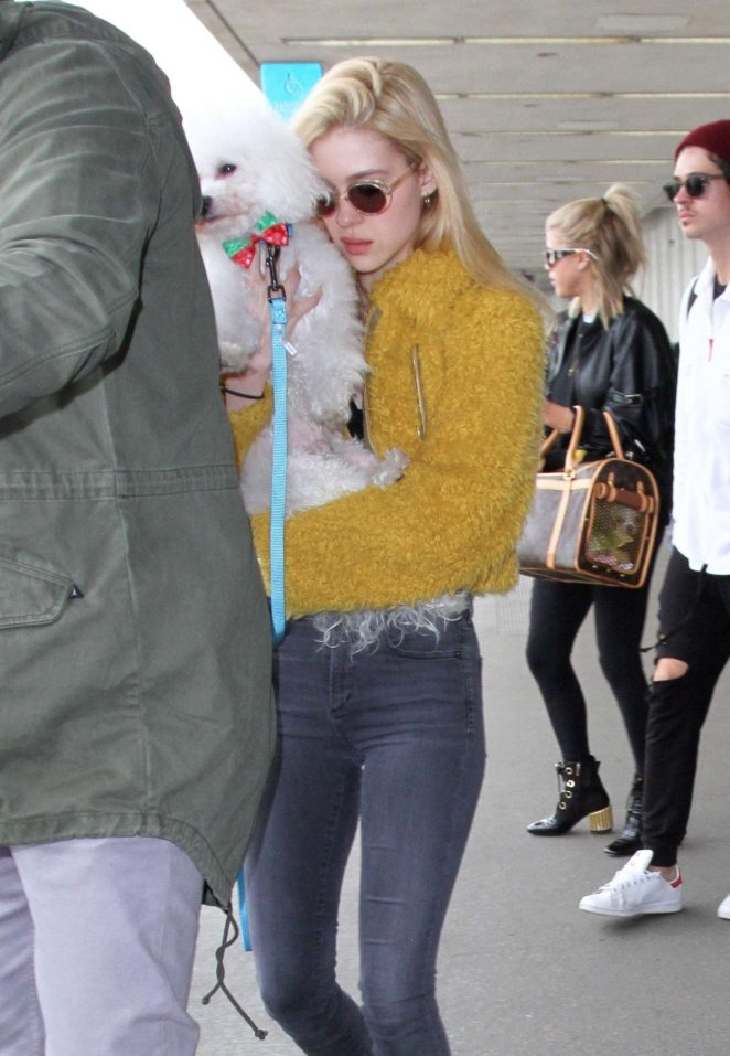Nicola Peltz in Furry Yellow Jacket at LAX Airport in Los Angeles