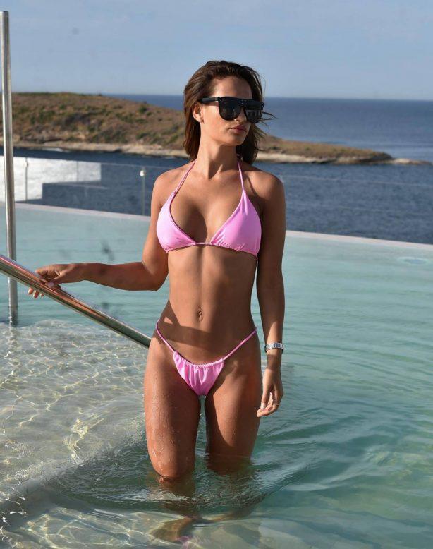 Nicole Bass - In a bikini in the pool at her hotel in Cyprus